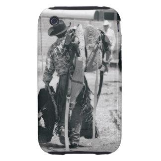 Rear view of cowboy hauling gear tough iPhone 3 case