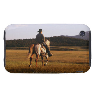 Rear view of cowboy riding horse tough iPhone 3 cover