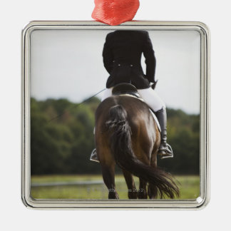 rear view of female dressage rider exercising christmas ornament