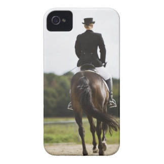 rear view of female dressage rider exercising iPhone 4 cases