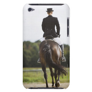 rear view of female dressage rider exercising iPod touch case