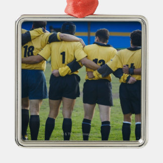 Rear view of rugby team standing with their arms Silver-Colored square decoration