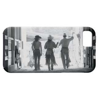 Rear view of three ranch hands leaving stable iPhone 5 cover