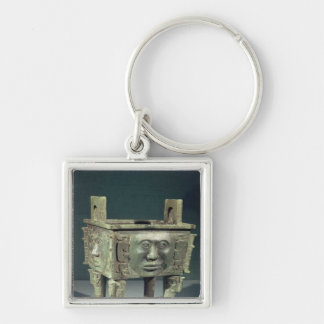 Rectangular 'ting' vessel with human faces Silver-Colored square key ring