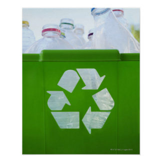 Recycling logo cut out of green plastic poster
