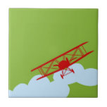 Red airplane on plain lime green. tiles