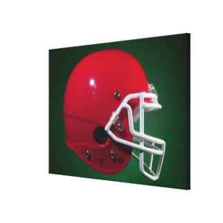 Red American football helmet on green background Canvas Print