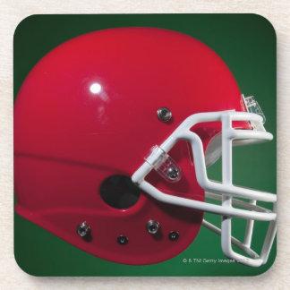 Red American football helmet on green background Coaster