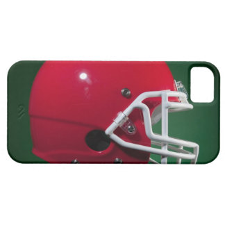 Red American football helmet on green background iPhone 5 Case
