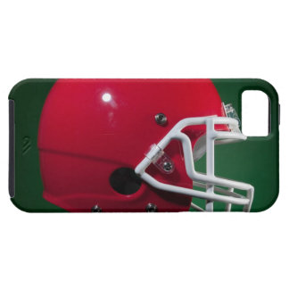 Red American football helmet on green background iPhone 5 Cover
