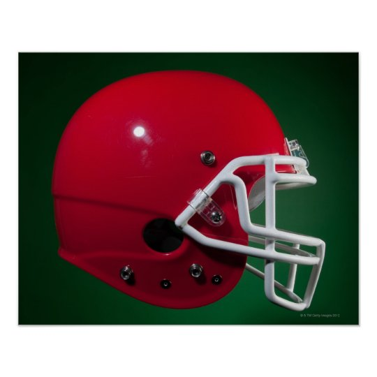 Red American football helmet on green background Poster
