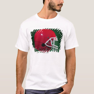 Red American football helmet on green background T-Shirt