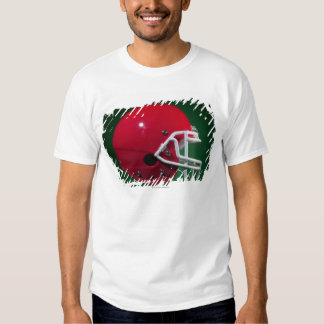 Red American football helmet on green background Tees