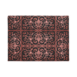 Red and black scrollwork pattern doormat