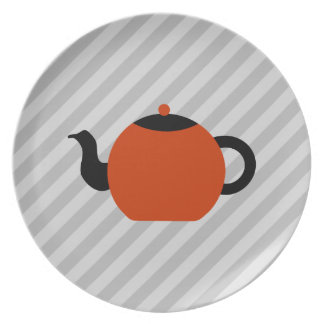 Red and black teapot design, on gray stripes. plate