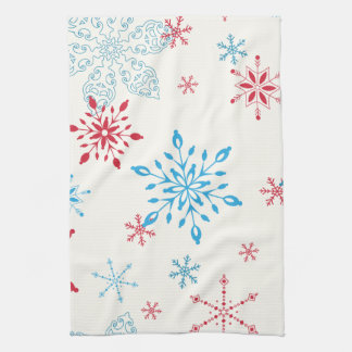 Red and Blue Snowflakes on a white background Tea Towel