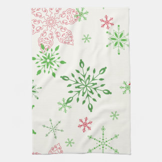 Red and Green Snowflakes on a white background Tea Towel