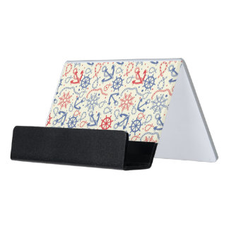 Red and navy background with anchor desk business card holder