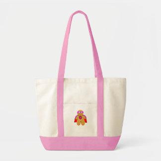 red and pink gingerbread man super hero character impulse tote bag