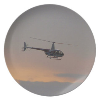 Red and white R44 at sunset. Plates