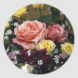 Red and yellow flowers in brass bowl classic round sticker