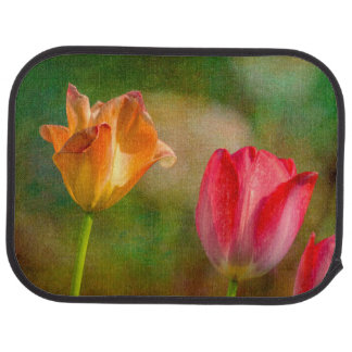 Red and yellow tulips on textured background car mat