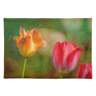 Red and yellow tulips on textured background placemat