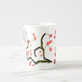 Red Apple Blossoms show on a Tea Cup