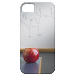 Red apple sitting on teachers desk iPhone 5 cover