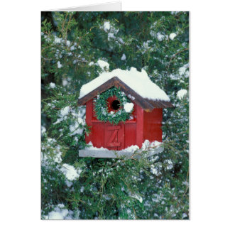 Red barn birdhouse decorated with a wreath card