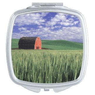 Red barn in wheat & barley field in Whitman 2 Compact Mirror