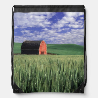 Red barn in wheat & barley field in Whitman 2 Drawstring Bag