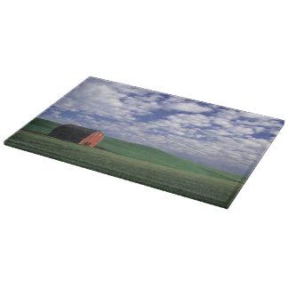 Red barn in wheat & barley field in Whitman Cutting Board