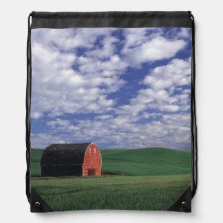 Red barn in wheat & barley field in Whitman Drawstring Bag