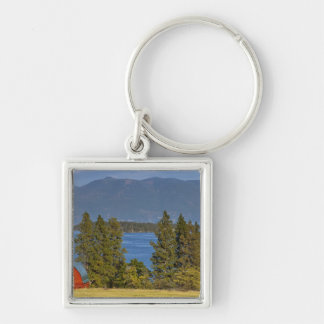 Red barn sits along scenic Flathead Lake near Silver-Colored Square Key Ring