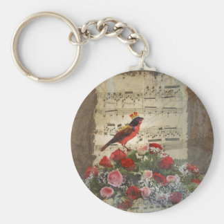 Red bird roses on vintage music sheet keychain