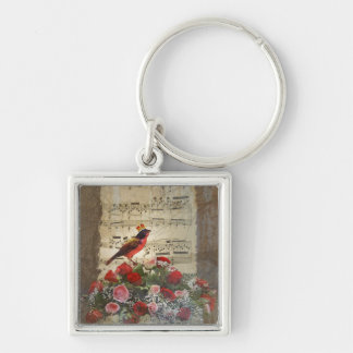 Red bird roses on vintage music sheet keychains