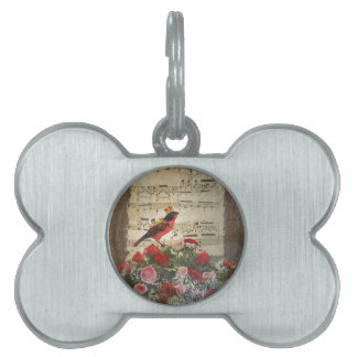 Red bird,  & roses  on vintage music sheet pet ID tag