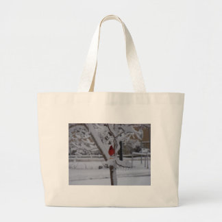 Red Bird winter storm Tote Bag