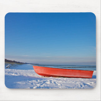 Red boat on shore of the Baltic sea in winter Mouse Pad