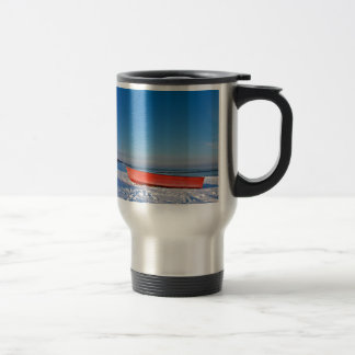 Red boat on shore of the Baltic sea in winter Stainless Steel Travel Mug