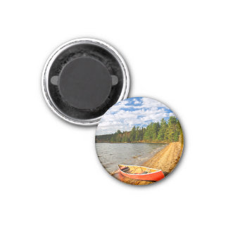 Red canoe on lake shore 3 cm round magnet