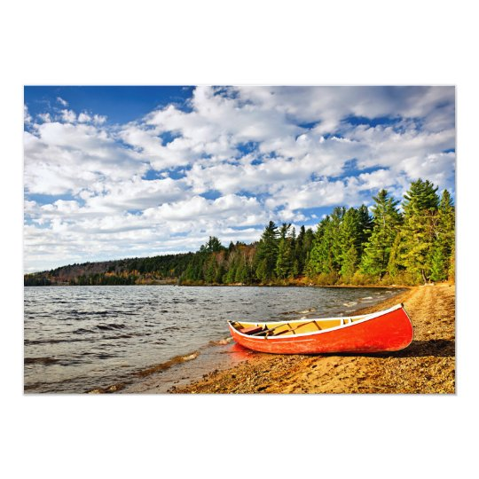 Red canoe on lake shore card