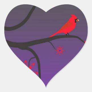 Red Cardinal bird in a tree on purple background. Heart Sticker