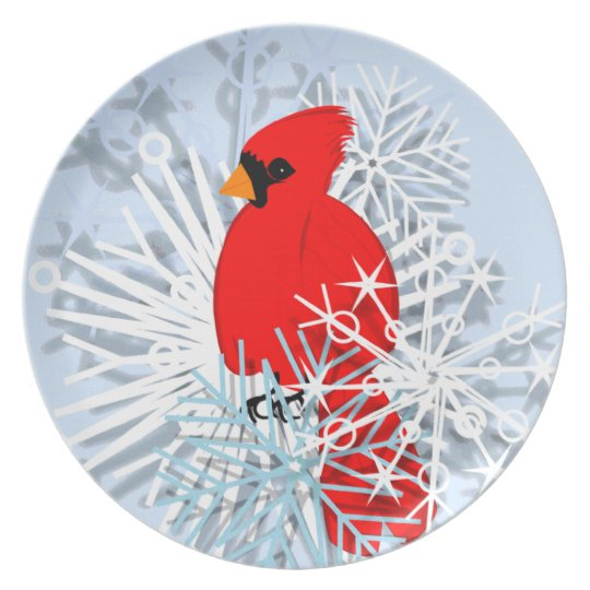 Red cardinal in snow stars plate