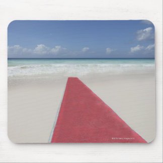 Red carpet on a beach mousepad