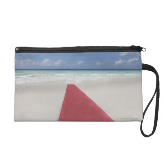 Red carpet on a beach wristlet