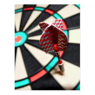 Red checkered dart on dartboard postcard