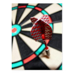 Red chequered dart on dartboard post cards