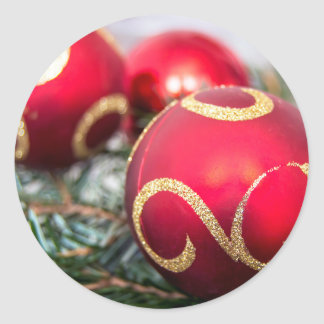 Red Christmas baubles Round Sticker